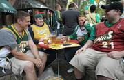 """South downtown business such as Swannie's Sportsbar in Pioneer Square stand to have a spike in business by fans like (left to right) Neil DeMerritt, Andy Sheridan, Brian Green and Corey Pike if a new NBA/NHL sports arena is built in Sodo. Here, the men attend a """"Bring back the Sonics"""" rally at Occidental Park in Seattle on Thursday."""