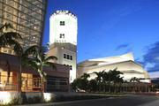 The Arsht Center lines both sides of Biscayne Boulevard and incorporates a historic tower.