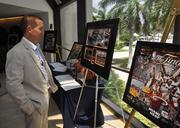 Malcolm Butters of Butters Construction looks at the Orange Bowl memorabilia at the silent auction.