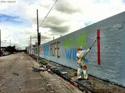 "Graffiti artist Above working on his Wynwood mural that reads, ""Give a Wall St. banker enough rope and he will hang himself."""