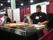Houston-based Russo's, a coal-fired pizza concept, was handing out samples at the Franchise Expo South at the Miami Beach Convention Center.