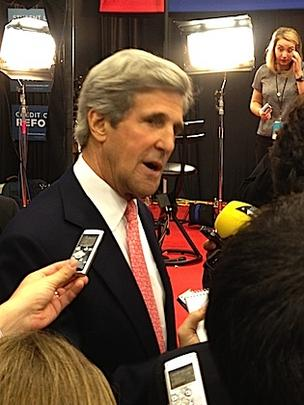 U.S. Sen. John Kerry visits 'spin alley,' a media interview area set up in Lynn University's gym.