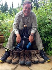 Mike B. Fernandez shows the shoes he broke in hiking.