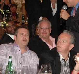 Ted Morse, right, watches as Scott Rothstein bids at a charity auction.