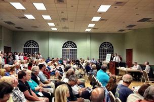 Fort Lauderdale Mayor Jack Seiler addresses a crowd at a public meeting about beach erosion on Monday night.