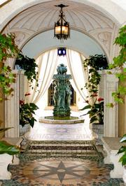 Archways leading up to a fountain at Casa Casuarina.