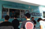 Attendees lined up for grilled cheese sandwiches at the Cheezios truck.