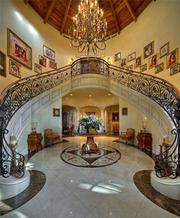Grand dual staircase at 2900 N.E. 37th St. in Fort Lauderdale