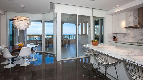 The kitchen and terrace at 7143 Fisher Island Drive.