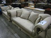 Several couches and chairs in the auction.