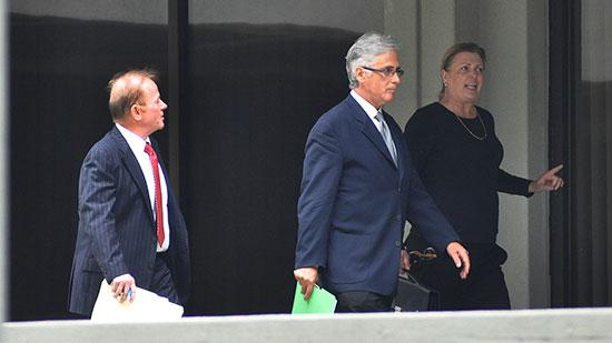 Marvin Chaney, center, leaves U.S. District Court in Fort Lauderdale on Tuesday, with his attorney, Larry Wrenn, left, and an unidentified woman.