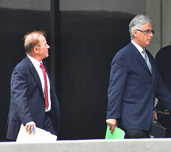 Marvin Chaney (left) owner of RoboVault and his attorney Larry Wrenn were ruled to be in contempt of court.