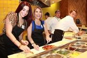 Guests help prepare specialty pizzas with California Pizza Kitchen chefs.