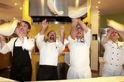 California Pizza Kitchen chefs toss pizza dough into the air during a opening preview at Sawgrass Mills Mall on Thursday.