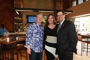 California Pizza Kitchen CEO G.J. Hart and his wife Heather pose for a picture with Sunrise Mayor Michael Ryan during a preview of the new location at Sawgrass Mills Mall.