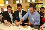 Guests try a variety of specialty pizza dishes at the new California Pizza Kitchen in Sawgrass Mills Mall, which will open to the public on Dec. 3.