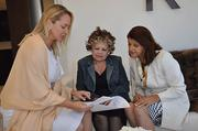 Attorney Heather Rutecki, left, meets with Jeannette Branam and Jeannette Varela, owners of property on Star Island.