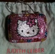 A Judith Lieber purse with Hello Kitty design.