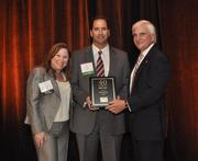 Daniel Diaz of TotalBank accepts his award.