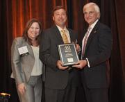 Sky Groden of Cushman & Wakefield accepts his award.
