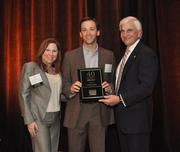 Adam Lustig of Bilzin Sumberg Baena Price & Axelrod LLP accepts his award.