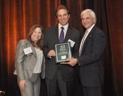 David Metalonis of Colliers International South Florida accepts his award.