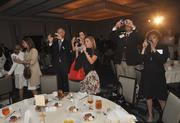 Members of the audience get captured by Business Journal photographer Mark Freerks as they take their own pictures.