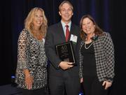 Helander, honoree Tim Gifford of CBRE and Dickinson.