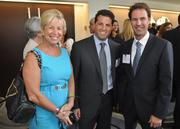Susan Kaplan of Daszkal Bolton with honoree Doug Mandel of Marcus & Millichap and Scott Garvis of Dale Carnegie.