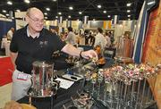 Dave Moreland of Smart Buffet Ware in Alabama lists his title as chief bottle washer. He uses his products to show off jelly beans.
