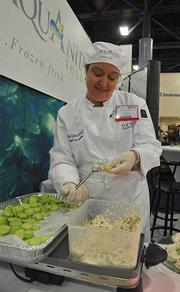 Erin-Lynn Tuckwell making tilapia for Aquanita, which markets itself as having high quality standards.