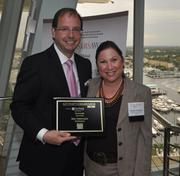 Honoree Bob Feldmann of McGladrey and Melanie Dickinson, president and publisher of the South Florida Business Journal.