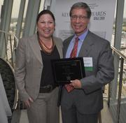 Melanie Dickinson, president and publisher of the South Florida Business Journal, and honoree Stephen Danner of CBIZ.