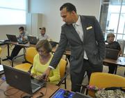 Flory takes a PC class with instructor Kimmel Menendez.