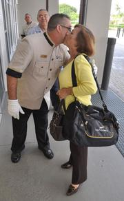 Alberto Rodriguez welcomes Flory Miranda at the front door of Leon Medical Center. The white glove approach was adopted from Marriott, but the greeters have the practical purpose of ensuring elderly patients get into the centers comfortably.