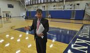 "Malfitano stands in the gymnasium area that will turn into ""Spin Alley,"" where sources can give their views to journalists."