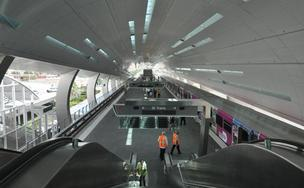Escalators in the foreground take passengers to the Rental Car Center, which is connected to the airport by the MIA Mover. The escalators in the middle go to the bus level.