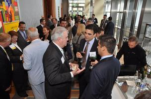 Mike Moore of Kaufman Rossin talks to honoree Jose Prendes of PureFormulas at the Miami Ultimate CEO Awards 2012, held at the Four Seasons Hotel, Miami.