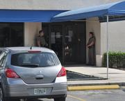 Officers secure Security Bank as federal regulators step it to seize the institution.