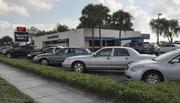 Security Bank's parking lot in North Lauderdale is packed as regulators transfer the failed bank to new owner Banesco USA.