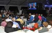 Viewers watch the presidential debate on the Lynn University soccer field.