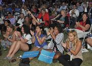 The crowd sitting on the soccer field at Lynn University cheers as the presidential debate begins.