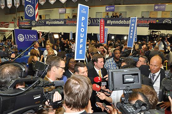 David Plouffe, President Barack Obama's former campaign manager, answers questions from reporters after the debate.