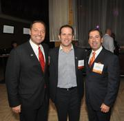 The Entrepreneurs' Organization's incoming president, Mark Sanna, current president, Michael Pool, and immediate past president, Oscar DiVeroli.