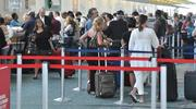 Passengers wait in lines on Monday morning at the Continental Airlines ticket counter at Fort Lauderdale-Hollywood International Airport.