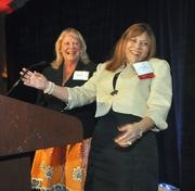 Lynne Cameron of Neighbors 4 Neighbors and Nelly Rubio of WFOR TV accept the 2011 MassMutual Citizenship Award.