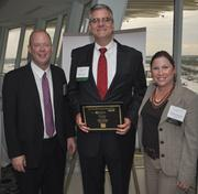 South Florida Business Journal Editor Kevin Gale, John Archer of Marcum and Melanie Dickinson, president and publisher of the Business Journal.