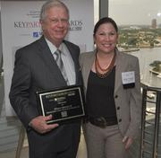 Honoree Wilson Atkinson III of Atkinson Diner Stone Mankuta & Ploucha and Melanie Dickinson, president and publisher of the South Florida Business Journal.