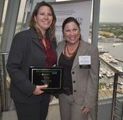 Honoree Kerensa Butler of McGladrey and Melanie Dickinson, president and publisher of the South Florida Business Journal.