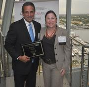 Honoree and former Miami Mayor Manuel Diaz of Lydecker Diaz and Melanie Dickinson, president and publisher of the South Florida Business Journal.
